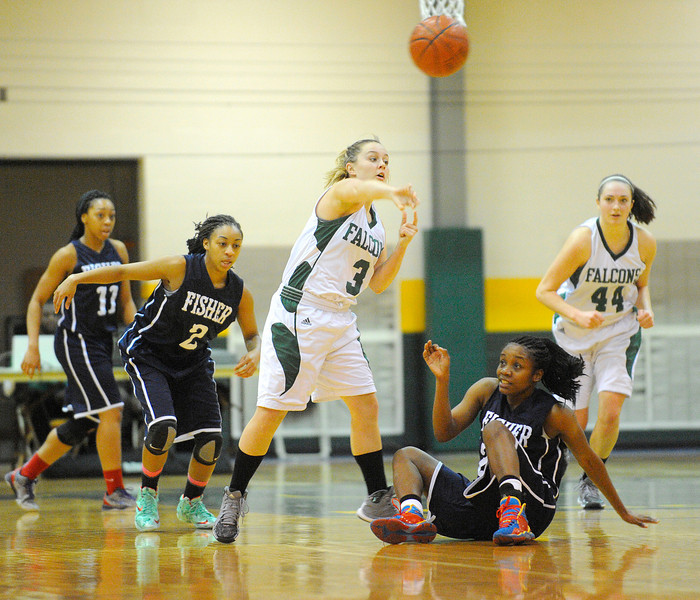 Fitchburg State's Tori Cyrus makes a long pass up court during Saturday's game against Fisher College, Saturday.<br /> SENTINEL & ENTERPRISE / BRETT CRAWFORD