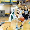 Fitchburg State'sAndreya DeSousa drives while defended by Fisher College's Victoria Park, Saturday.<br /> SENTINEL & ENTERPRISE / BRETT CRAWFORD
