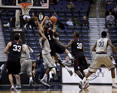 Christian Webster of Harvard drives to basket