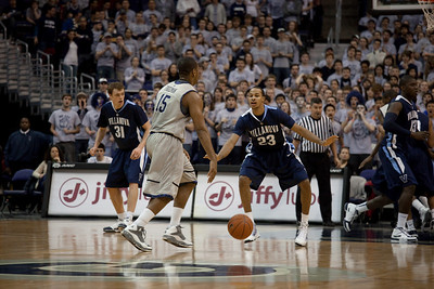 Austin Freeman guarded by Dominic Cheek