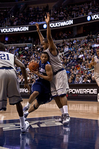Corey Fisher is guarded by Austin Freeman.