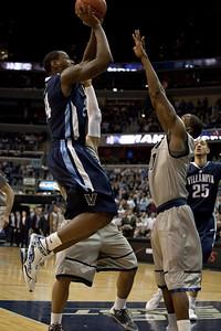 Corey Stokes shoots over Jason Clark
