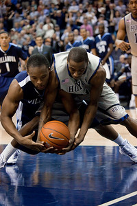 Maalik Wayns and Jason Clark dive for the ball