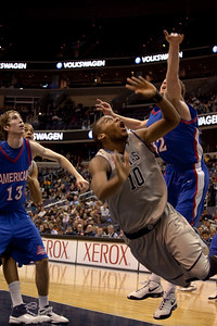 Greg Monroe defended by Stephen Lumkins and Riley Grafft