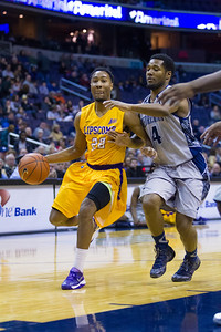 22	J.C. Hampton of Lipscomb guarded by 4 D'Vauntes Smith-Rivera of the Hoyas