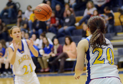 Line Mountian's Jade London passes the ball to Sarah Lahr during the Eagles' 60-57 win over Millville on Friday night in Herndon.