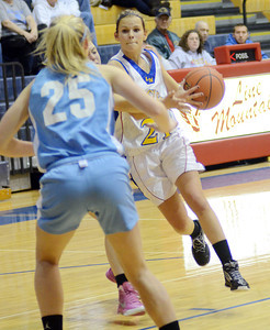 Line Mountain's Sarah Lahr attempts to dribble past Millville's Madi Bower on Friday night during the Eagles 60-57 win in Herndon.