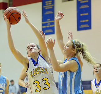 Line Mountain's Colleen Troutman reaches for a rebound during the Eagles' win over Millville 60-57 on Friday night in Herndon.