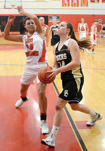 Mount Carmel's Christina Perles goes for a block as Southern Columbia's Mallory Tomaschik starts her layup, during Wednesday night's game in Mount Carmel.