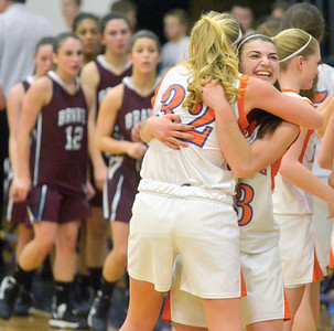 Danville's Liza Davis and Kylie Romeo hug after defeating Shikellamy during Tuesday night's district playoff in Shamokin.