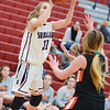 Shikellamy's Brooke Snyder shoots over Benton's Naomi Baker during Saturday's game in Sunbury.