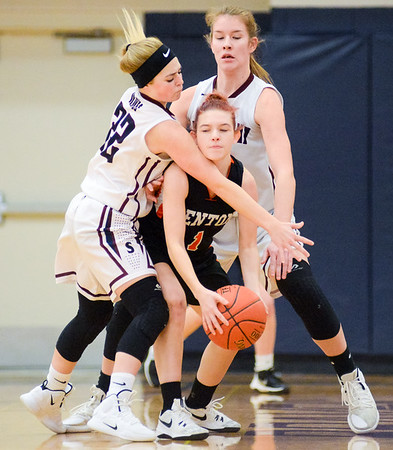 Shikellamy's Tori Scheller and Tralyn Hummel play tight defense on Benton's Trinity Brown during Saturday's game in Sunbury.