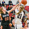 Shikellamy's Tori Smith shoots over Benton's Emily Lockard during Saturday's game in Sunbury.