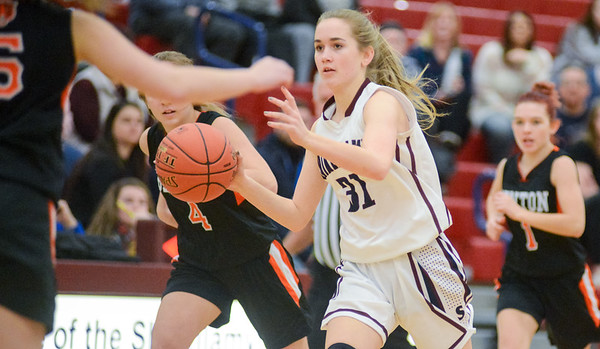 Shikellamy's Brooke Snyder dribbles through the Benton defense on Saturday afternoon.