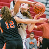 Shikellamy's Tralyn Hummel fights for a shot against Benton's Evie Bowman during Saturday's game in Sunbury.