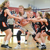 Shikellamy's Tralyn Hummel grabs a rebound between Benton's Emily Lockard, Cecelia Huntington and Sasha Farr during Saturday's game in Sunbury.