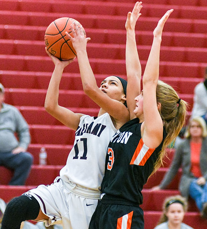 Shikellamy's Jordan Moten makes a layup against Benton's Cecelia Huntington during Saturday's game.