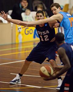 Jeromie Hill, Jarrod Camble - NBL Pre Season Basketball: Gold Coast Blaze v University of Texas San Antonio; Carrara, Gold Coast, Queensland, Australia. Photos by Des Thureson:  http://disci.smugmug.com.