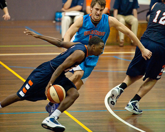 Zac Carter, AJ Price - NBL Pre Season Basketball: Gold Coast Blaze v University of Texas San Antonio; Carrara, Gold Coast, Queensland, Australia. Photos by Des Thureson:  http://disci.smugmug.com.