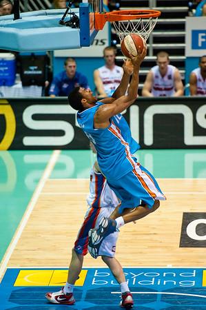 """Darryl Hudson again impresses with great facial expressions and a very nice vertical leap - Gold Coast Blaze v Adelaide 36ers NBL Basketball; Queensland, Australia; Sunday 13 February 2011. Photos by Des Thureson:  <a href=""""http://disci.smugmug.com"""">http://disci.smugmug.com</a>"""