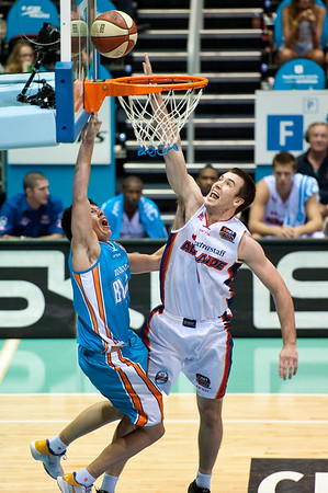 "Jason Cadee v Brad Hill - Gold Coast Blaze v Adelaide 36ers NBL Basketball; Queensland, Australia; Sunday 13 February 2011. Photos by Des Thureson:  <a href=""http://disci.smugmug.com"">http://disci.smugmug.com</a>"