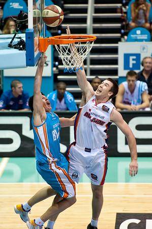 "Jason Cadee v Brad Hill - Gold Coast Blaze v Adelaide 36ers NBL Basketball; Queensland, Australia; Sunday 13 February 2011. Photos by Des Thureson:  <a href=""http://disci.smugmug.com"">http://disci.smugmug.com</a>"
