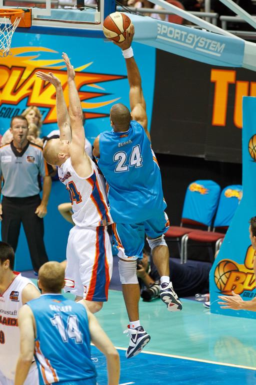 """Ira Clark v Adam Ballinger - Gold Coast Blaze v Adelaide 36ers NBL Basketball; Queensland, Australia; Sunday 13 February 2011. Photos by Des Thureson:  <a href=""""http://disci.smugmug.com"""">http://disci.smugmug.com</a>"""