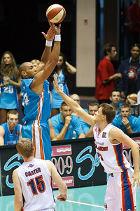 Ira Clark v Daniel Johnson - Gold Coast Blaze v Adelaide 36ers NBL Basketball; Queensland, Australia; Sunday 13 February 2011. Photos by Des Thureson:  http://disci.smugmug.com