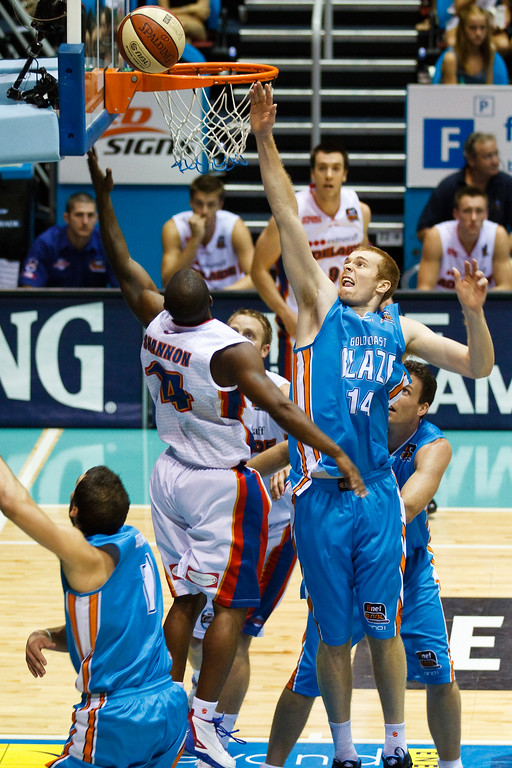 "Eddie Shannon v Tom Garlepp - Gold Coast Blaze v Adelaide 36ers NBL Basketball; Queensland, Australia; Sunday 13 February 2011. Photos by Des Thureson:  <a href=""http://disci.smugmug.com"">http://disci.smugmug.com</a>"