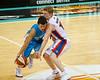 """The 36ers' Ryhs Carter defends closely the Blaze' Jason Cadee - Gold Coast Blaze v Adelaide 36ers NBL Basketball; Queensland, Australia; Sunday 13 February 2011. Photos by Des Thureson:  <a href=""""http://disci.smugmug.com"""">http://disci.smugmug.com</a>"""