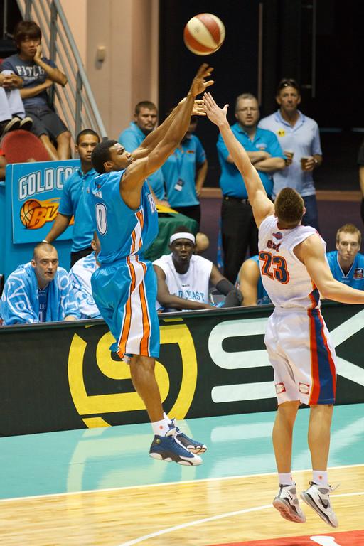 "Darryl Hudson v Mitch Creek - Gold Coast Blaze v Adelaide 36ers NBL Basketball; Queensland, Australia; Sunday 13 February 2011. Photos by Des Thureson:  <a href=""http://disci.smugmug.com"">http://disci.smugmug.com</a>"