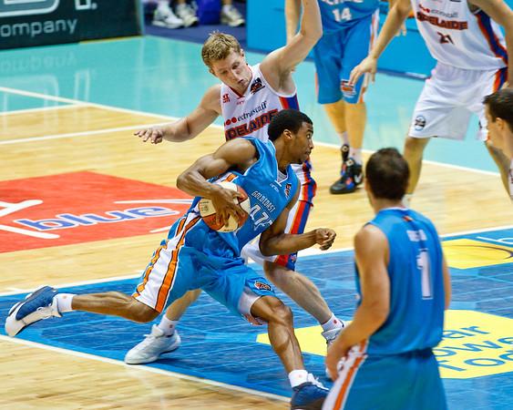 "Darryl Hudson v Rhys Carter - Gold Coast Blaze v Adelaide 36ers NBL Basketball; Queensland, Australia; Sunday 13 February 2011. Photos by Des Thureson:  <a href=""http://disci.smugmug.com"">http://disci.smugmug.com</a>"