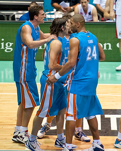 NBL Veterna Stephen Hoare 'soothes' Chris Goulding after the foul - Gold Coast Blaze v Adelaide 36ers NBL Basketball; Queensland, Australia; Sunday 13 February 2011. Photos by Des Thureson:  http://disci.smugmug.com