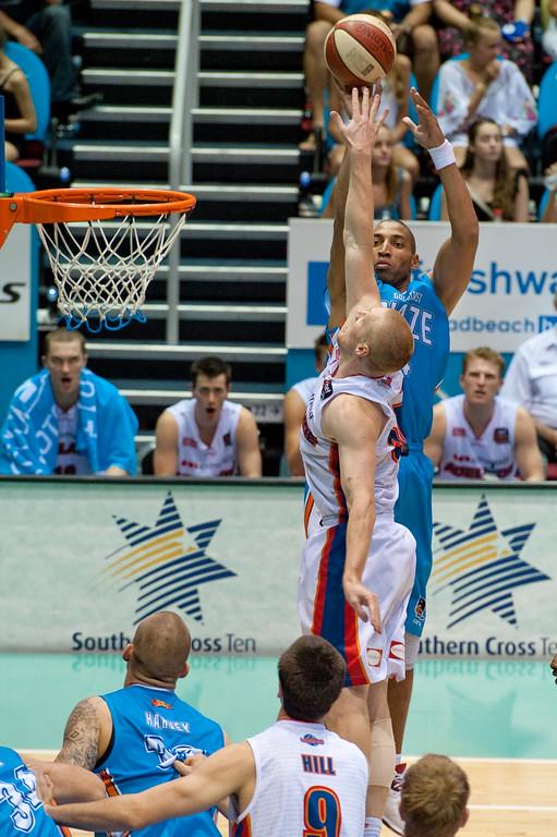 """Adam Ballinger defends Ira Clark - Gold Coast Blaze v Adelaide 36ers NBL Basketball; Queensland, Australia; Sunday 13 February 2011. Photos by Des Thureson:  <a href=""""http://disci.smugmug.com"""">http://disci.smugmug.com</a>"""