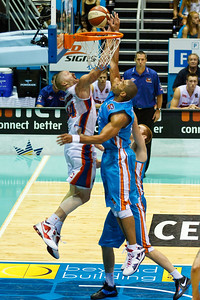 Ira Clark v Adam Ballinger - Gold Coast Blaze v Adelaide 36ers NBL Basketball; Queensland, Australia; Sunday 13 February 2011. Photos by Des Thureson:  http://disci.smugmug.com