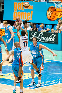 Ron Howard shows the elevation against James Harvey, as Stephen Hoare looks on - Gold Coast Blaze v Adelaide 36ers NBL Basketball; Queensland, Australia; Sunday 13 February 2011. Photos by Des Thureson:  http://disci.smugmug.com