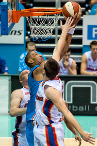 Excellent block by Brad Hill against Ira Clark - Gold Coast Blaze v Adelaide 36ers NBL Basketball; Queensland, Australia; Sunday 13 February 2011. Photos by Des Thureson:  http://disci.smugmug.com