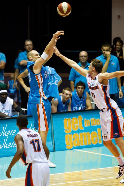 "James Harvey v Daniel Johnson - Gold Coast Blaze v Adelaide 36ers NBL Basketball; Queensland, Australia; Sunday 13 February 2011. Photos by Des Thureson:  <a href=""http://disci.smugmug.com"">http://disci.smugmug.com</a>"