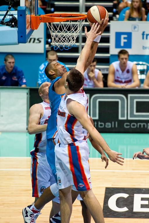 """Excellent block by Brad Hill against Ira Clark - Gold Coast Blaze v Adelaide 36ers NBL Basketball; Queensland, Australia; Sunday 13 February 2011. Photos by Des Thureson:  <a href=""""http://disci.smugmug.com"""">http://disci.smugmug.com</a>"""