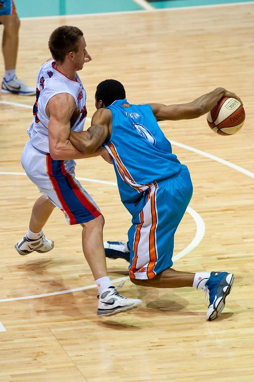 """Darryl Hudson against Mitch Creek - Gold Coast Blaze v Adelaide 36ers NBL Basketball; Queensland, Australia; Sunday 13 February 2011. Photos by Des Thureson:  <a href=""""http://disci.smugmug.com"""">http://disci.smugmug.com</a>"""