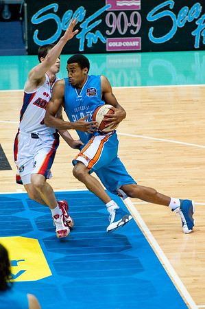"Darryl Hudson again impresses with great facial expressions and a very nice vertical leap - Gold Coast Blaze v Adelaide 36ers NBL Basketball; Queensland, Australia; Sunday 13 February 2011. Photos by Des Thureson:  <a href=""http://disci.smugmug.com"">http://disci.smugmug.com</a>"