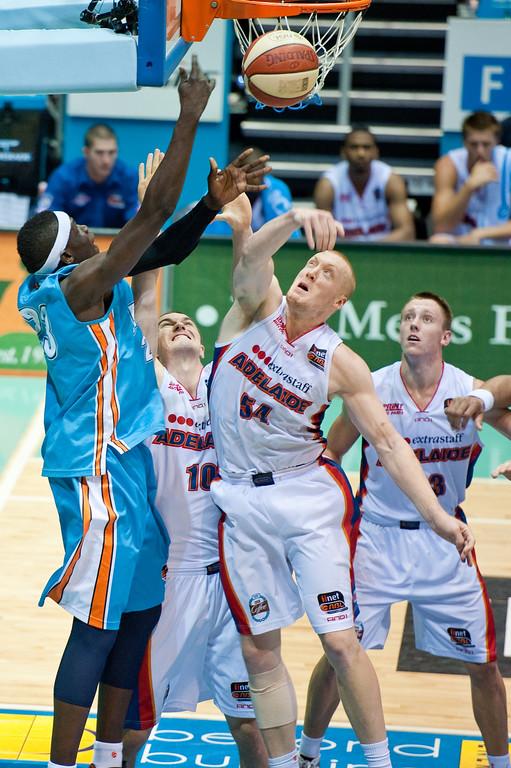 """Ater Majok v Adam Ballinger & Jeff Dowdell - Gold Coast Blaze v Adelaide 36ers NBL Basketball; Queensland, Australia; Sunday 13 February 2011. Photos by Des Thureson:  <a href=""""http://disci.smugmug.com"""">http://disci.smugmug.com</a>"""