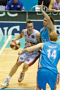MItch Creek v Chris Goulding - Gold Coast Blaze v Adelaide 36ers NBL Basketball; Queensland, Australia; Sunday 13 February 2011. Photos by Des Thureson:  http://disci.smugmug.com