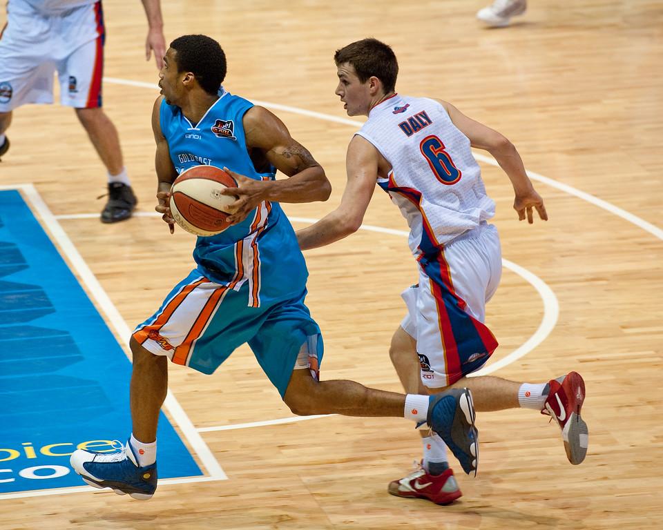 "Darryl Hudson beats Tom Daly - Gold Coast Blaze v Adelaide 36ers NBL Basketball; Queensland, Australia; Sunday 13 February 2011. Photos by Des Thureson:  <a href=""http://disci.smugmug.com"">http://disci.smugmug.com</a>"