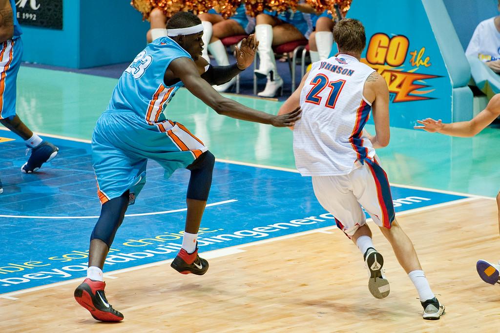 """Battle of the Big Men - New Blaze recruit Ater Majok defends the drive of Daniel Johnson - Gold Coast Blaze v Adelaide 36ers NBL Basketball; Queensland, Australia; Sunday 13 February 2011. Photos by Des Thureson:  <a href=""""http://disci.smugmug.com"""">http://disci.smugmug.com</a>"""