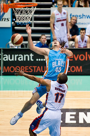 """Chris Goulding is fouled by Ron Howard on the way to the hoop. - Gold Coast Blaze v Adelaide 36ers NBL Basketball; Queensland, Australia; Sunday 13 February 2011. Photos by Des Thureson:  <a href=""""http://disci.smugmug.com"""">http://disci.smugmug.com</a>"""