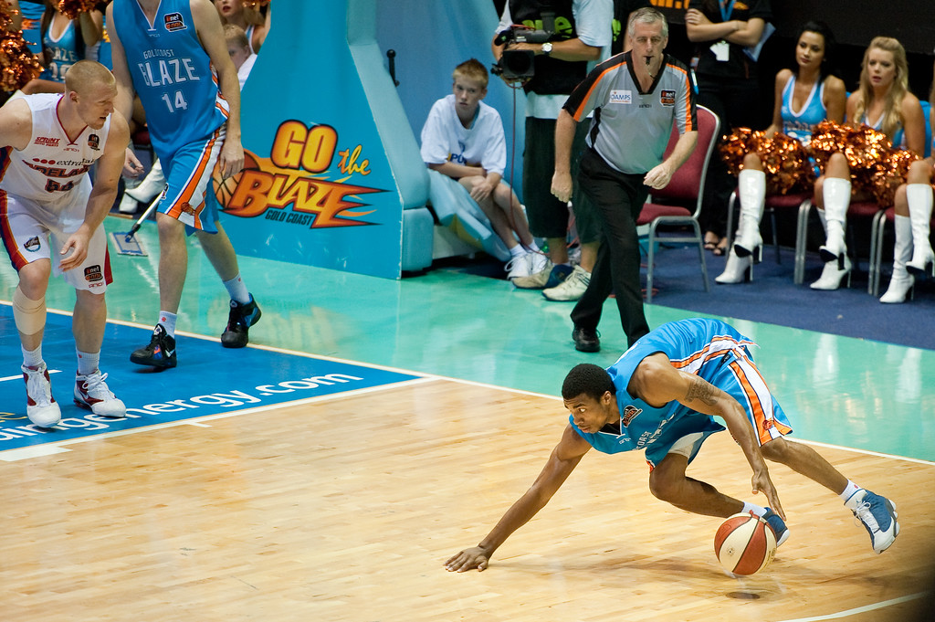 "Darryh Hudson 'recovers' - Gold Coast Blaze v Adelaide 36ers NBL Basketball; Queensland, Australia; Sunday 13 February 2011. Photos by Des Thureson:  <a href=""http://disci.smugmug.com"">http://disci.smugmug.com</a>"