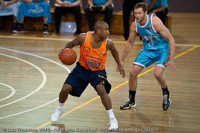 Anthony Petrie threatens the double-team against former team-mate Ayinde Ubaka - Gold Coast Blaze v Cairns Taipans pre-season NBL basketball game, Saturday 18 September 2010, Carrara, Gold Coast, Australia.