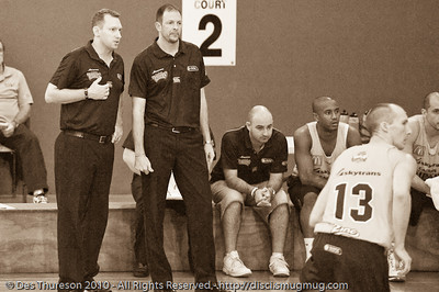 (L to R) Taipans Assistant Coach (and all-round nice guy) Mick Downer and Head Coach Aaron Fearne discuss the play - Gold Coast Blaze v Cairns Taipans pre-season NBL basketball game, Saturday 18 September 2010, Carrara, Gold Coast, Australia. Alternate Processing: LR Preset: 'Creative - Sepia'.