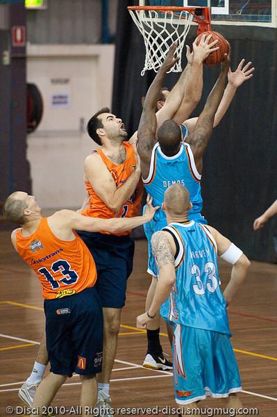 Ian Crosswhite (L), Anthony Petrei (obscured) & James Maye contest the rebound - Gold Coast Blaze v Cairns Taipans pre-season NBL basketball game, Saturday 18 September 2010, Carrara, Gold Coast, Australia.